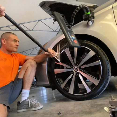 Man doing paintless dent removal orange county