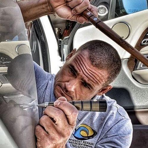 man doing a dent repair orange county