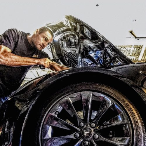 Man doing a dent repair orange county